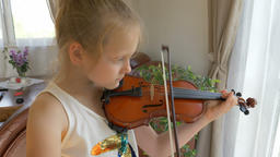 Young girl is playing viola. Music education Footage