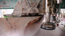 industrial saw sawing huge block of marble, slider shot Footage