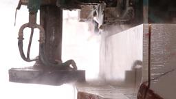 industrial saw sawing huge block of marble Footage