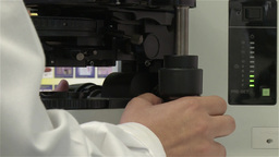 woman adjusting electronic microscope in a laboratory Electronic, slider shot Footage