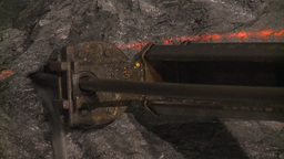 Underground drilling equipment working in a mine Footage