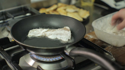 Chef cooking and breading fish in flour in restaurant kitchen. Restaurant. Food Footage