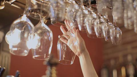 bartender hang beer glass. hanging beer glass Footage