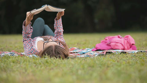 Relaxing Reading on Grass Footage