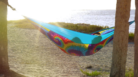 Happy girls on summer vacation relaxing in hammock Footage
