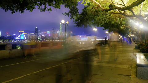 People walking on the embankment in evening city Footage