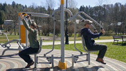 People exercising in an outdoor gym Footage