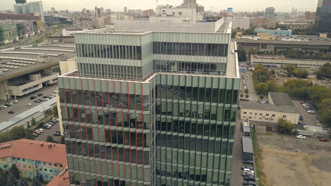 Drone view highrise business center building in city. Glass facade building フォト