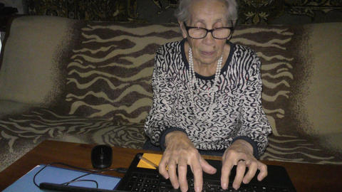 An elderly woman and a computer GIF