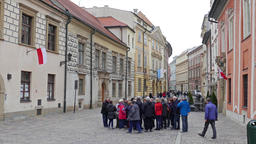 Group of tourists on the street of old town in Krakow, Poland Live Action