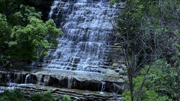 Waterfall panoramic landscape. View of isolated and rock layered waterfall Footage