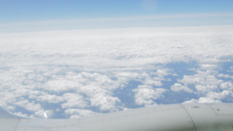 View through the window of the aircraft on the clouds and the wing, the flight Footage