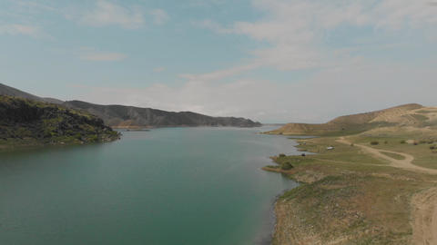 Flying over Azat Reservoir in Armenian Highlands. Cars and resting people along ビデオ