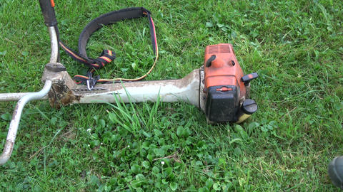 gardener pour gasoline petrol into lawn mower trimmer tank Live Action