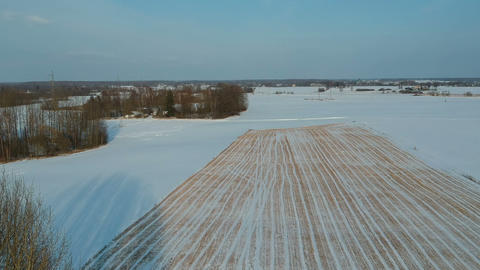 winter fallow stubble agriculture field with snow, aerial view Live Action