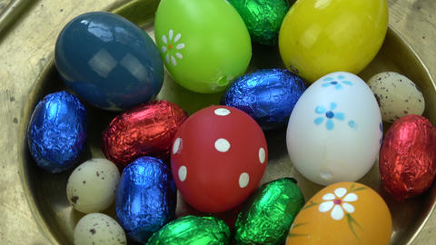 Rotating in brass plate decorative easter eggs background Footage