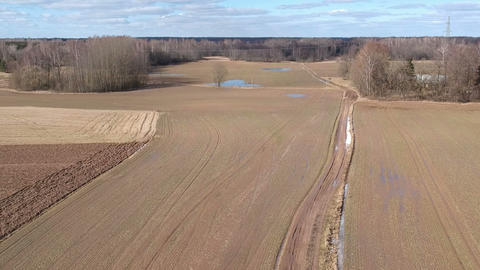 Early spring wet and bad rural road, aerial view Footage