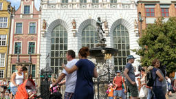 Gdansk, Poland. Old Town. Neptune fountain. Strolling tourists Live Action