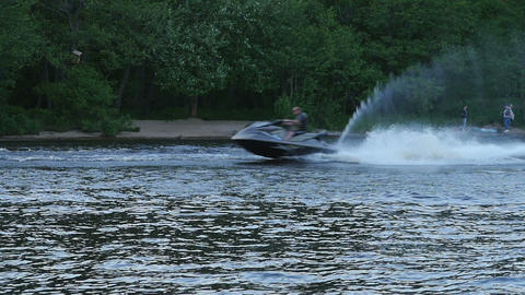 man on a jet ski at high speed Live Action