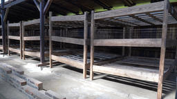 Beds for prisoners inside a dormitory barrack in Auschwitz concentration camp Live Action