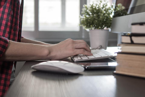 Creative woman using on computer for searching idea in the office Photo