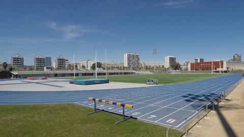 Blue Athletics Olympic Running Tracks With People Running On Them GIF