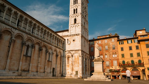 POV tracking shot of the Piazza San Michele in the Tuscan city of Lucca, Italy. GIF