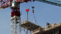 Heavy lifting construction crane on a building site. Architectural building and Footage