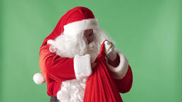 Santa Claus takes a pile of bills from a red bag, money concept green chromakey Footage
