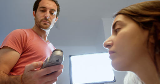 Male photographer recording an interview using voice recorder 4k Footage