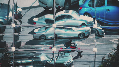 Street traffic distorted reflection on a mirror skyscraper facade Live Action