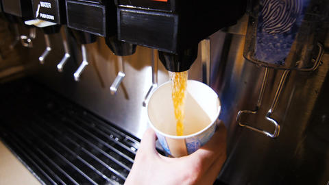 close view aromatic tea poured into cup from machine in cafe GIF