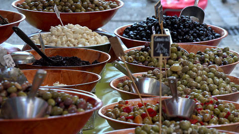 Dynamic shot of multicolored olives on a local farmers market Footage