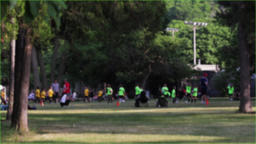 Group of soccer players getting ready to practice outdoors at a public field. 영상물