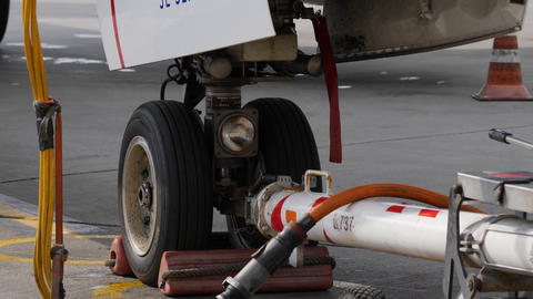 Aircraft ground handling. Fore undercarriage with pushback tug towbar and power Footage