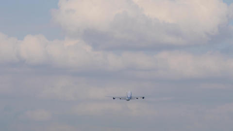 Big four-engine cargo airliner gains height after takeoff and flies to clouds Footage