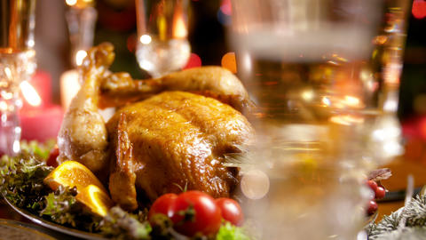 4k video of camera focusing on baked chicken for Christmas and bubbles in glass Footage