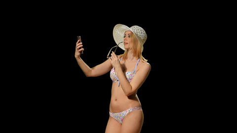 The blonde in a bathing suit makes selfie phone (alpha channel) Footage