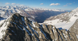 Majestic Aerial Panorama of Italian Alps With Valleys and Mountains Peaks Live Action