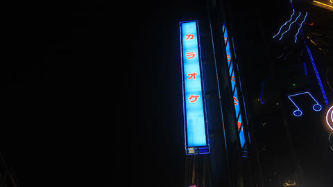Japanese neon board including chracter at Shinjuku low angle 動画素材, ムービー映像素材