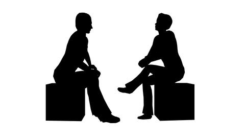 Silhouettes of two people sitting and talking on a white Live Action