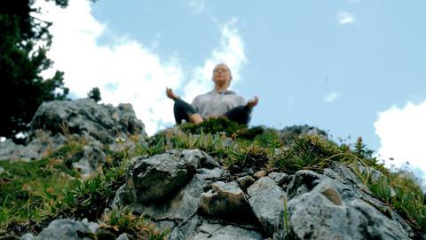 teen girl on mountain top does yoga exercises Photo