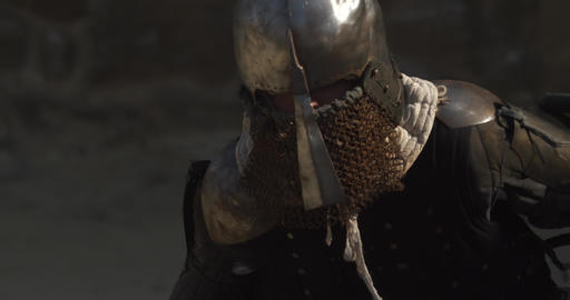 close up view to fighting warriors in helmets Live Action