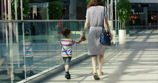 Rear view of woman and toddler son walking 영상물