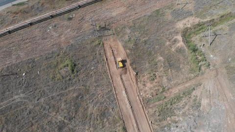 Aerial of tractor on field. Top view from height Live Action