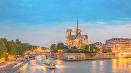 Paris France time lapse 4K, city skyline day to night timelapse at Notre Dame de Footage