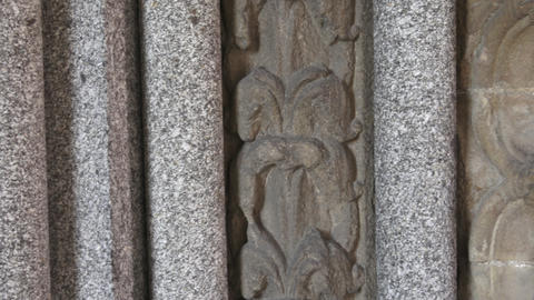 Building wall with decorations. Detail of ancient wall of stone with ornament Live Action
