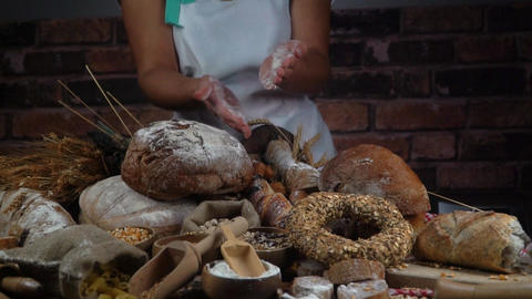 woman cutting bread in the bakery. slow motion Footage