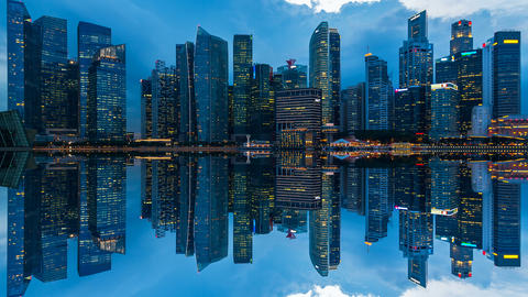 Time lapse of cityscape and reflections at night in Singapore. 4K Footage