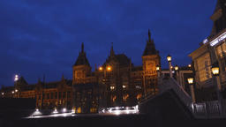 Building Exterior of Amsterdam Central Station at Twilight Live Action